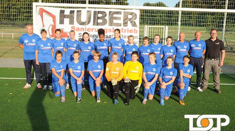 Die Mädchenmannschaft von Blau-Weiss Aachen und Sponsor Costa Huber